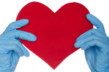 Two hands in blue medical gloves and heart