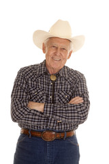 Elderly man cowboy arms folded