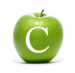 A green apple with a vitamin symbol isolated on white