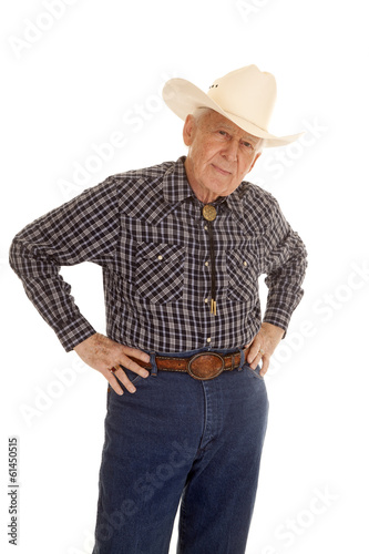 Elderly man cowboy hands hips