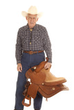 Elderly man cowboy saddle look