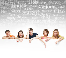 A group of teenagers with a giant, blank, white billboard