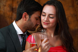 Couple romancing with wine, elegant expression