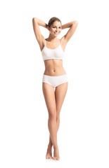 A beautiful girl in a white swimsuit isolated on white