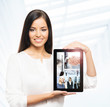 A brunette businesswoman showing a tablet pc with