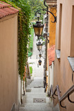 Narrow street with stairs and lamps