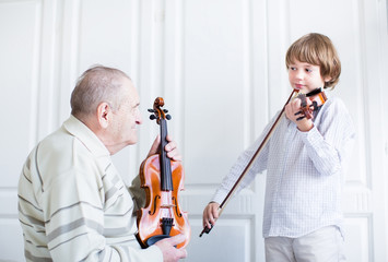 Great grandfarther listening to a child playing violin