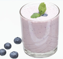 Glass full of blueberries yogurt
