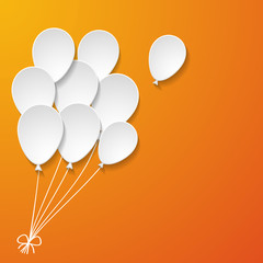 white paper balloons on the orange background