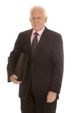 Elderly business man bag under arm