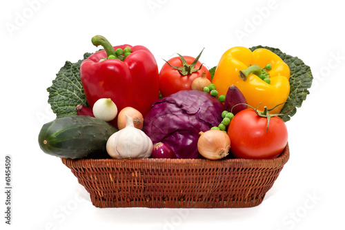 Basket full of peppers,onion,cucumber,cabbage,peas and tomatoes
