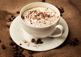 cappuccino on burlap background