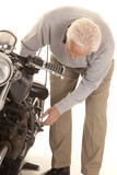 Elderly man check motorcycle