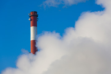 Chimneys with clouds of smoke, pollution on the environment.