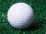 Golf ball ower green grass.