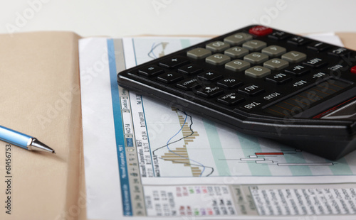 Closeup image of calculator keyboard on a document