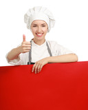 Chef woman holding a blank board and showing ok