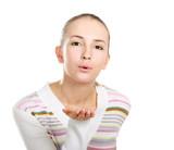 young beautiful woman giving an air kiss