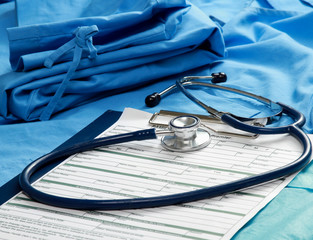 A stethoscope and RX prescription on a medical uniform.