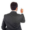 Young businessman turning his back to camera with pen