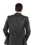 Young businessman turning his back to camera
