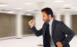 Businessman running in office because it is late