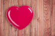 Love heart plate on wooden background