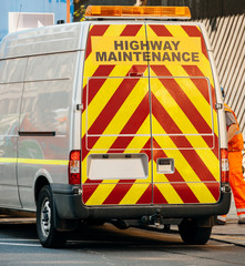 Highway maintenance van with security yellow and red stripes