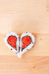 Two pieces of sushi forming th eheart shape