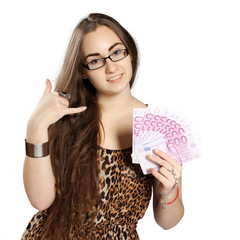 Teen girl holds money in a fan-shape