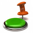 Fun orange thumbtack near green button