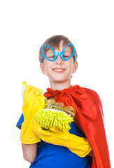 Funny child superhero cleaning with a sponge and sprayer