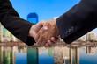 Businessman handshake with building background