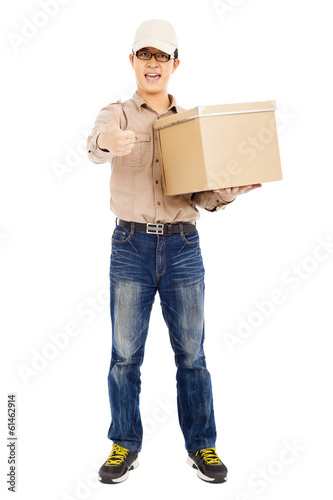 Delivery man holding goods and thumb up