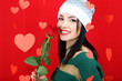 Attractive young woman with heart on Valentine Day