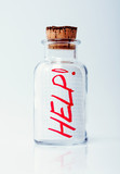 "Creative help concept. Bottle with a message ""Help!"""