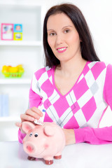 woman with piggy bank and money