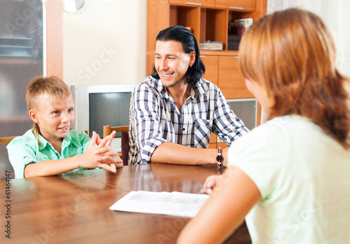 Son and father answer questions of a social worker