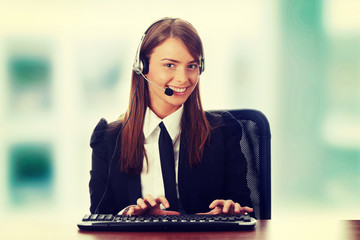 Young beautiful customer service operator girl in headset