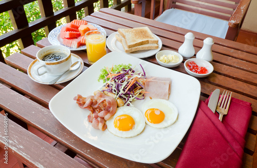 set of american breakfast on wood table