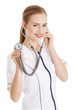 Young caucasian nurse or doctor is listening through stethoscope
