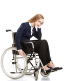 Sad, serious business woman sitting on wheelchair.
