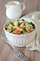 Salad with chicken, carrots, eggs and cucumbers