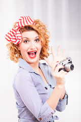 Portrait of elegant retro style woman with photo camera.