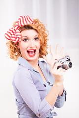 Portrait of elegant retro style woman with photo camera.