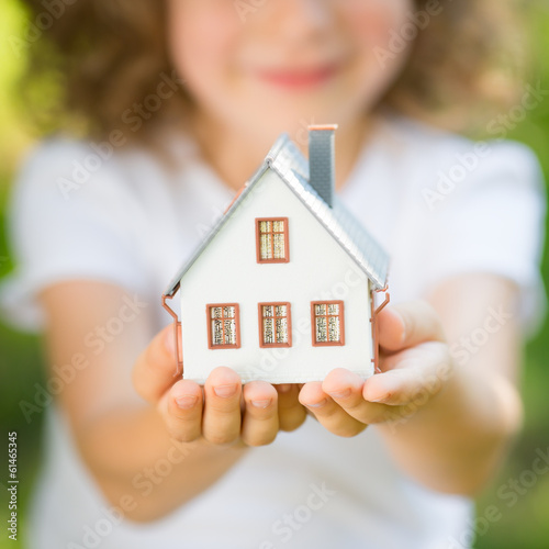 Child holding house