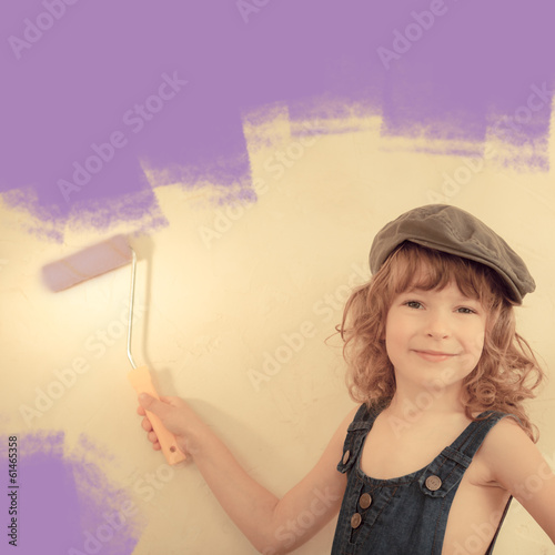 Kid painting wall