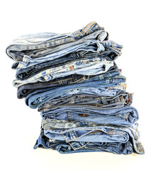 stack of blue jeans isolate