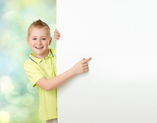 Handsome boy pointing to blank advertisement banner
