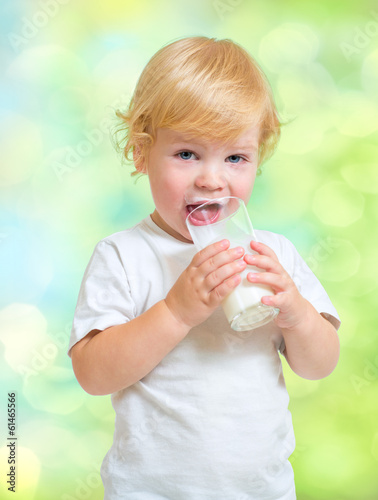 Child drinking dairy product from glass
